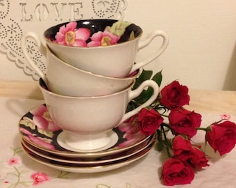 1930s Vintage English bone china hand painted tea cup and saucer made by Salisbury china. TS090. Stunning pink on black tea cup and saucer.