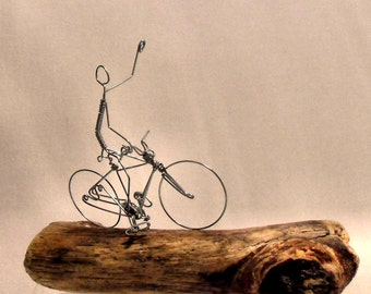 Bicycle Sculpture with rider on Driftwood.