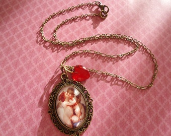Cherub necklace:  Antique brass love cherub angel glass dome cameo heart charm necklace nickel and lead free