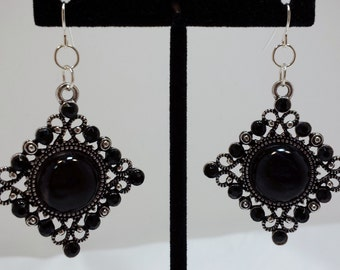 Black medallion earrings