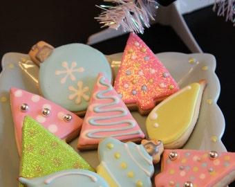 One dozen pastel Christmas cookies