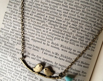 Feathered friends bird necklace with vintage flower