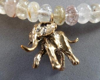 Smooth rutilated quartz -  goldfilled hook clasp - etched brass cones  - oxidized bronze elephant -  Elephas Choker