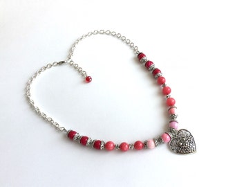 Pink, coral, and berry ombre bead silver chain necklace with filigree heart pendant