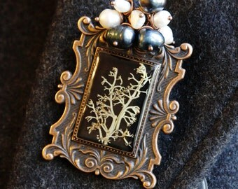 The Victorian era. Jewelry Set. Large brooch and vintage earrings.