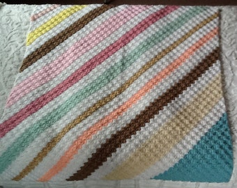 Crocheted lap afghan in pastel multi colored stripes