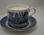 Candle in a tea cup with saucer