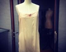 1920s soft silk palest peach chemise/step-in with silk ribbon rosette, unworn