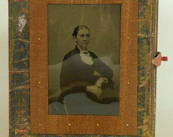 Book with Tin Type on Cover.    (145)