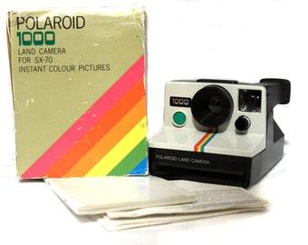 Polaroid 1000 Land Cámera - green button [includes original box and original book instruccions]