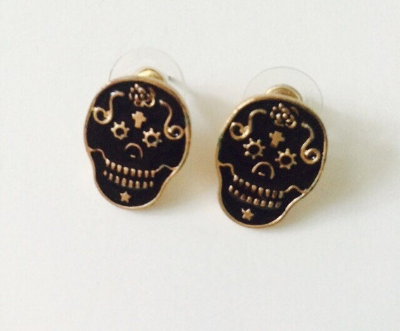 black enamel skull earrings