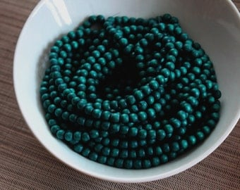 6mm Pine Green Wood Beads - Dyed and Waxed - 15-inch strand