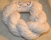 Handspun pure suri alpaca yarn in natural white.