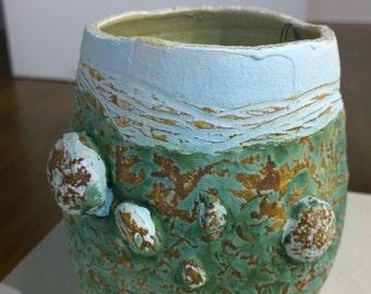 Green dry glazed sea urchin sea shell vase.