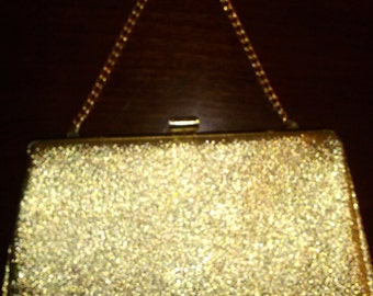 Vintage Gold metallic finish purse/clutch with fold away handle.