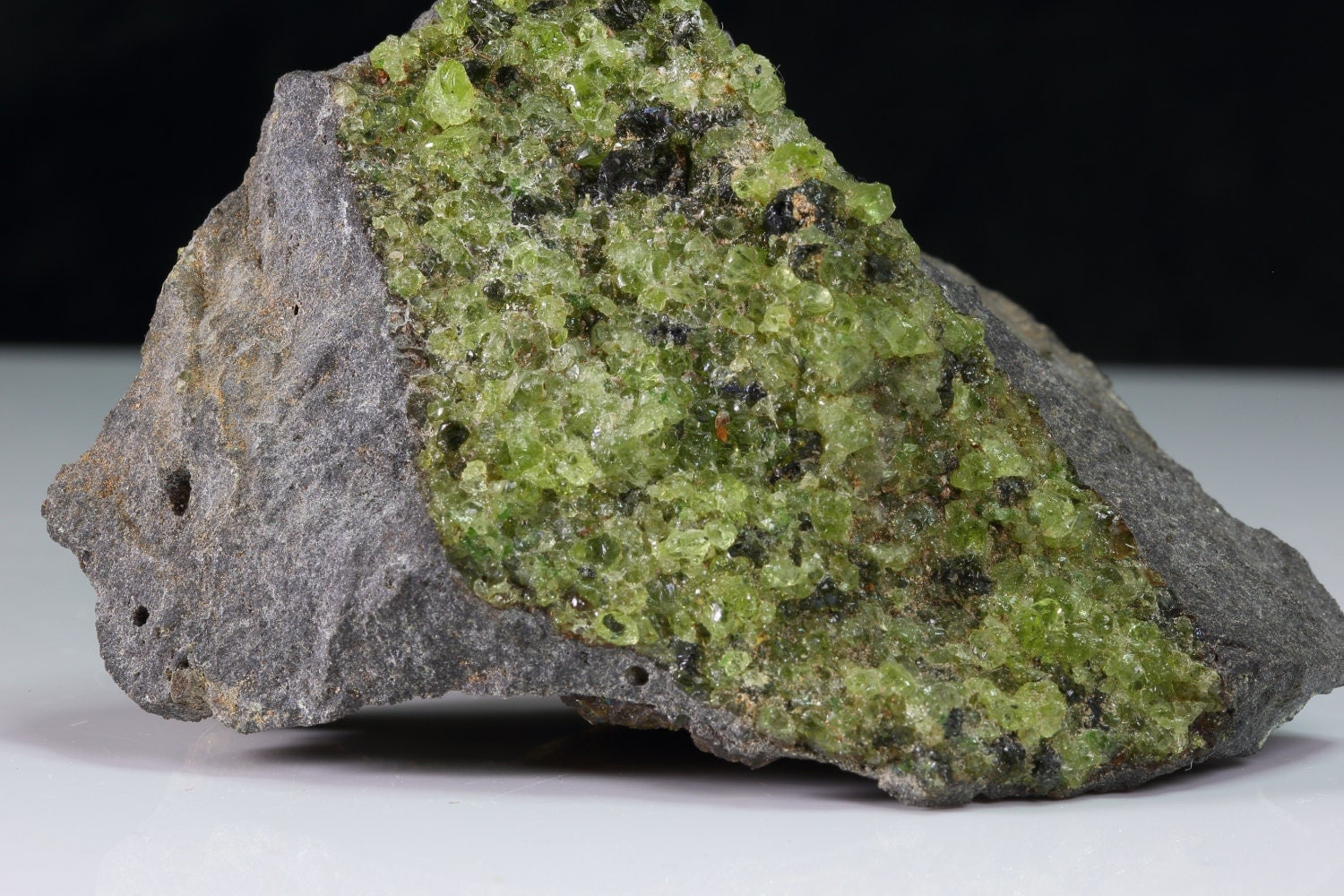 Polished Olivine Basalt : Uncommon light to dark green olivine peridot with precious