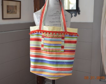 This is a very cute beach bag or a overnight bag.