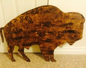 Distressed bison wall hanging.