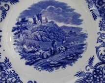 George Jones Blue Transferware 10 3/8 inch Plate in the Pastoral Pattern featuring Sheep resting on the hillside. Made in England.