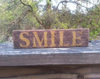 Rustic wood SMILE sign.