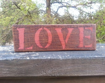 Rustic wood LOVE sign.