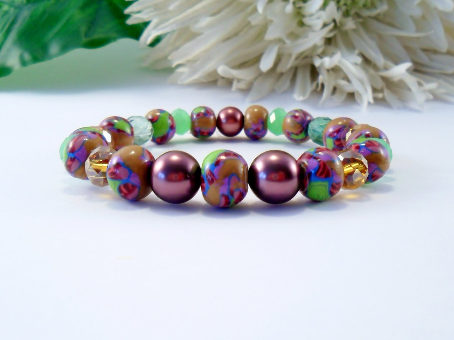 a multi colored stretch beaded bracelet with handmade by