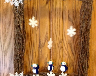 Rectangular grapevine wreath with snowmen and snowflakes