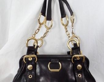 90s Stuart Weitzman brass stirrup and chain black leather doctors bag/small shoulder purse