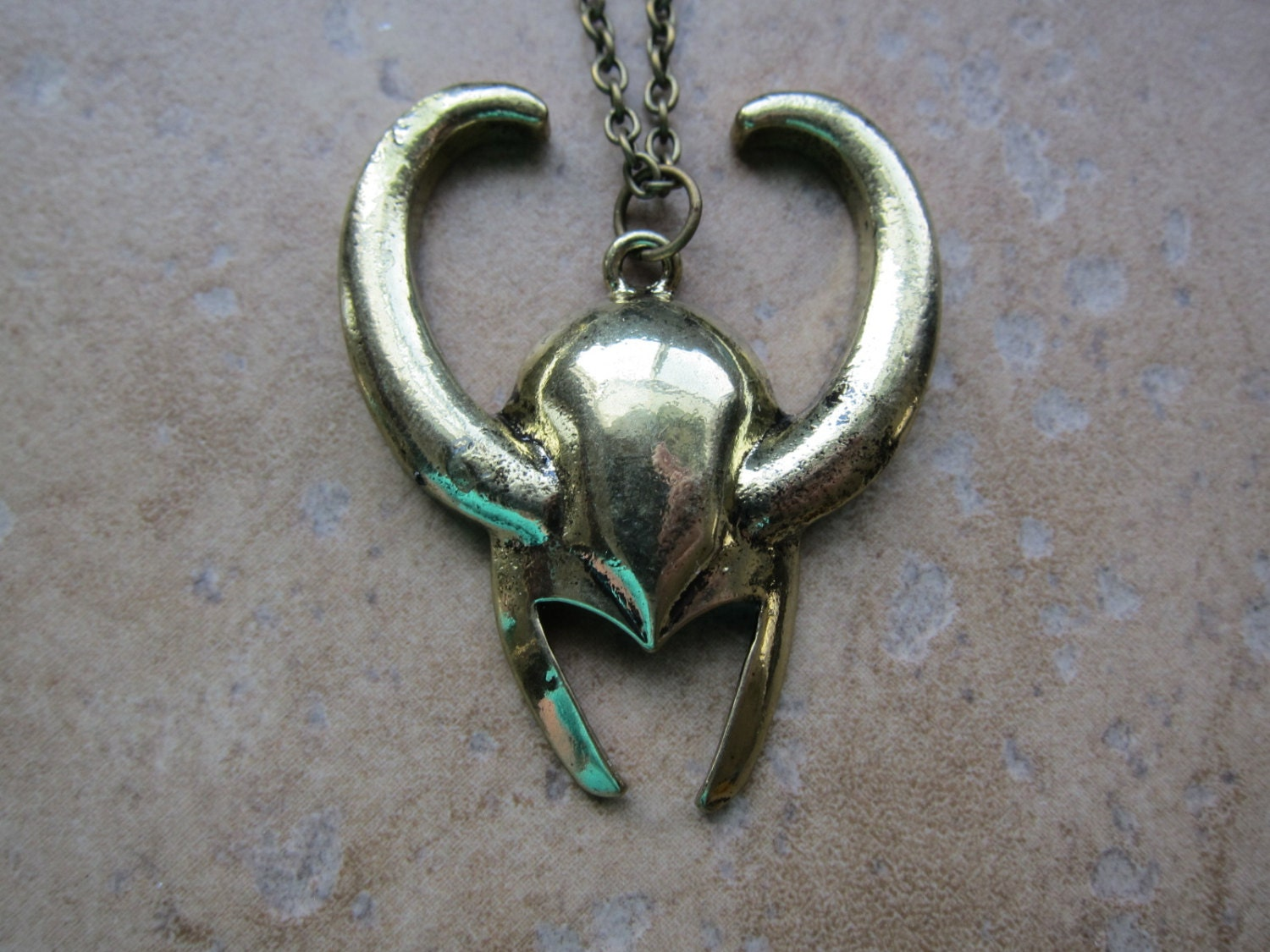 gold tone loki pendant necklace inspired by thor by