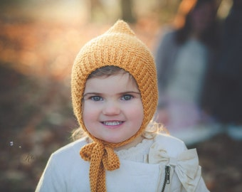 Baby hand knitted bonnet in mustard yellow/ unique and cute hat for newborn/ knit pixie hat/ photo prop