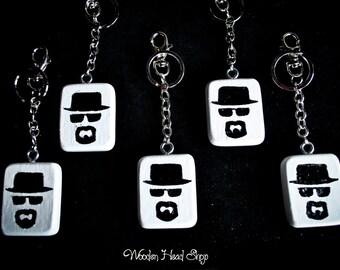 Heisenberg Breaking Bad keychain handmade with solid oak wood; metal chain; Diamensions: 4 x 5 cm .