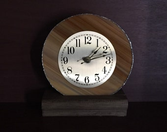 Brown stained glass clock with wooden base