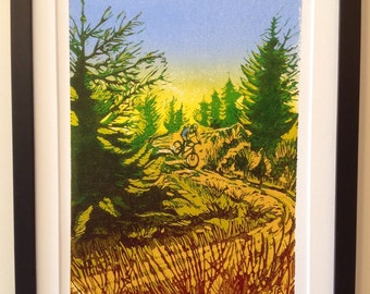 Original handpulled linocut print of a mountainbiker descending a forest track.  Limited edition of 10