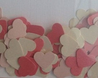 Hearts made from pinks and ivory shades of coloured cardstock, 1.5cm wide. Ideal for table confetti, cardmaking and general crafting.