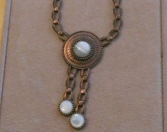 A  1928 brass & mother of pearl necklace