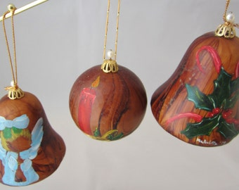 Vintage X-mas Ornaments-1979 unusual hand painted with artists' signature. Made to look like real wood but probably are plastic. Collectible