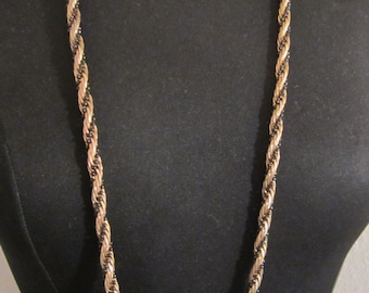 Vintage Necklace Circa 1950's. Gold Tone Twisted Rope Style with strings of tiny seed beads wraped around the piece. Striking elegant piece.