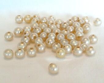 54 vintage ivory glass pearls