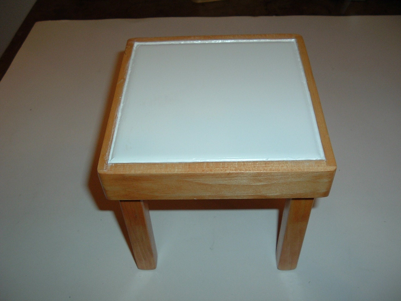 Handmade wooden plant stand for a table top or hot plate
