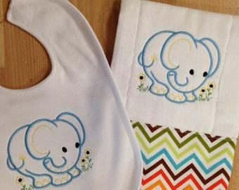 elephant bib and burp cloth set.  Cute blue elephant with chevron fabric trim on the burp cloth.  coordinating bib to match.