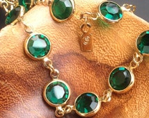 Signed SWAROVSKI CRYSTAL Station Necklace Emerald Green with Gold Swan Tag Big Crystals Bezel Set