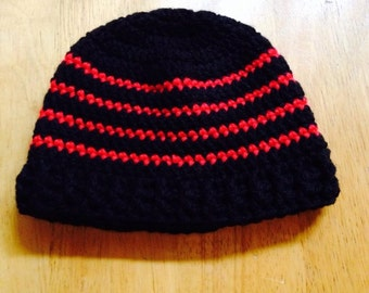 Black with red stripes baby hat for newborn to three-month old baby with ribbed edging