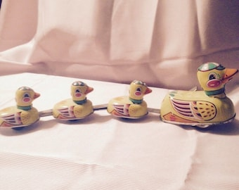 Tin toy wind up duck family