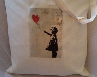 Banksy inspired  artwork reworked  heatpress transfer on a tote. Eco bag