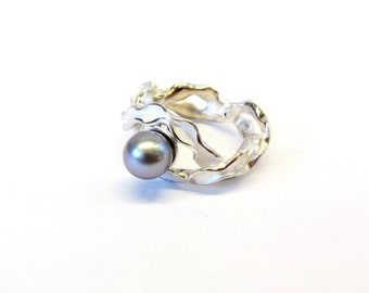 Silver braided ring with freshwater pearl in color of choice.