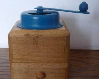 Vintage old coffee grinder for children 1950 wood metal
