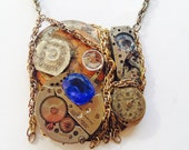 The Fulton Necklace: steampunk watch pendant with white and blue rhinestones