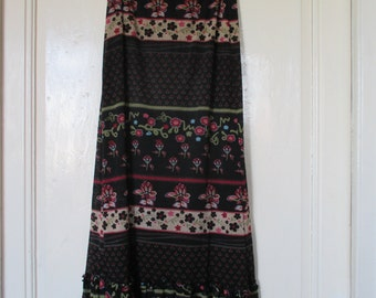 ENDOFSUMMER code for 25% discount 90s printed ruffled  maxi skirt.