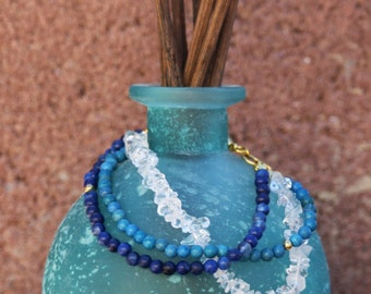 Crystal Stack Bracelet with shades of blue, turquoise, and crystal beads