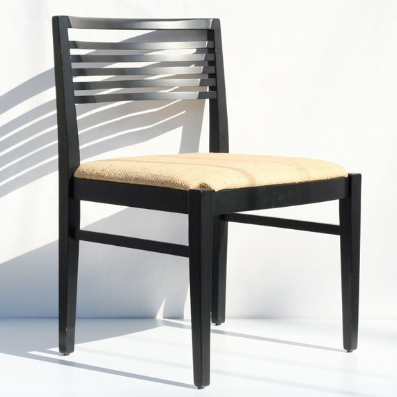 knollstudio ricchio wood side chair black frame and straw cushion